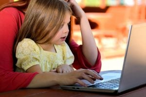 child mother laptop computer