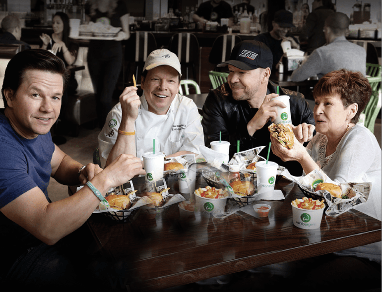 Wahlburgers Family around Table